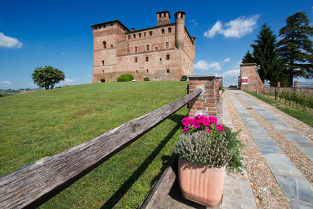 cavour: Grinzane Cavour, Italy - May 1, 2015: Spring view of the Castle of Grinzane Cavour Unesco heritage in the territory of the Langhe Piedmont Italy Editorial