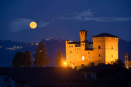 cavour: Grinzane Cavour, Italy - September 27, 2015: View in the night with a full moon on the Castle of Grinzane Cavour Unesco heritage in the territory of the Langhe Piedmont Italy Editorial