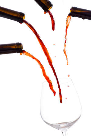 exaggerated: Four bottles, pour into a empty glass of wine at the same time
