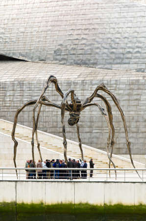 to seem: Bilbao, Spain - March 28, 2016: Maman sculpture, by Louise Bourgeois, Guggenheim Museum, Between the legs, numerous people seem trapped prey Editorial