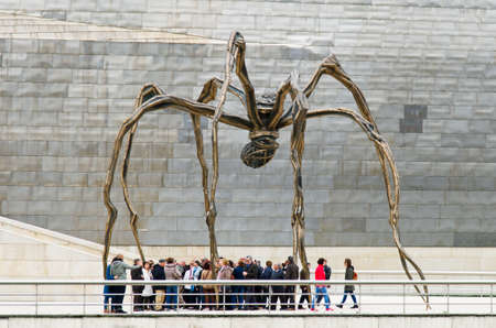 bourgeois: Bilbao, Spain - March 28, 2016: Maman sculpture, by Louise Bourgeois, Guggenheim Museum, Between the legs, numerous people seem trapped prey Editorial