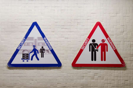 robbed: triangular sign to warn about the risk of being robbed by skilled pickpockets Stock Photo