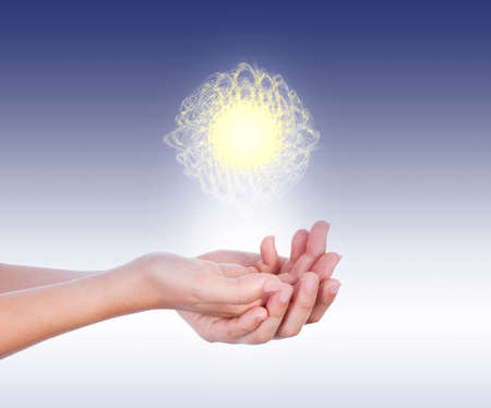 glowing: Energy sphere, white and yellow, levitates on hands in front of a blue background