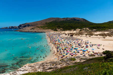 view on the beach of Cala Mesquida Majorca Spain with many tourists and calm sea Banco de Imagens