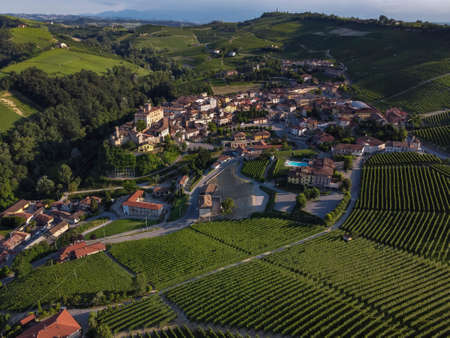 Drone view of the village of Barolo surrounded by hills and vineyards Langhe country