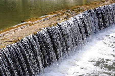 An acoustic waterfall in a creek near a park in Round Rock, Texas.