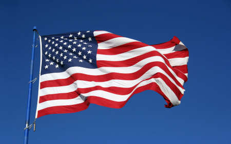 An American flag flaping boldly in the wind. Reklamní fotografie - 527130