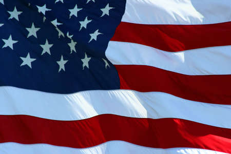 An American flag flaping boldly in the wind. Stock Photo - 733187