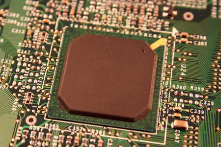 A close up of a computer motherboard chip. Banco de Imagens