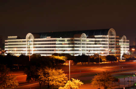 A building in the Dallas Texas Skyline at night. photo