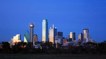 tx: A section of buildings in the Dallas Texas Skyline at dusk.