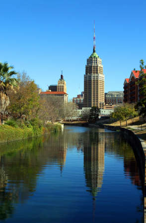 a riverwalk reflection of a tower in the San Antonio skyline Stock Photo