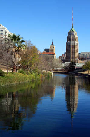a riverwalk reflection of a tower in the San Antonio skyline Imagens
