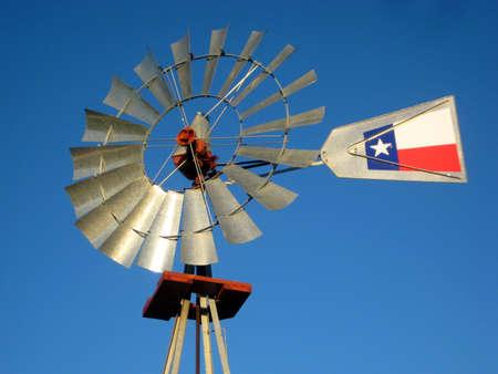 A windmill against the blue Texas sky.