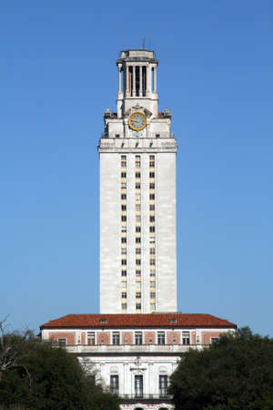 UT tower stands tall in downtown Austin, Texas. Imagens