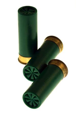Isolated on white unused green shotgun shells
