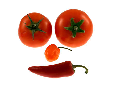 A face make out of peppers and tomatos Stock Photo