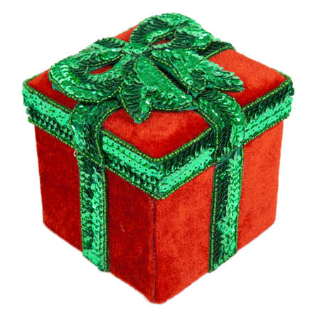 A red and green Christmas present box with a green bow on top of the lid.
