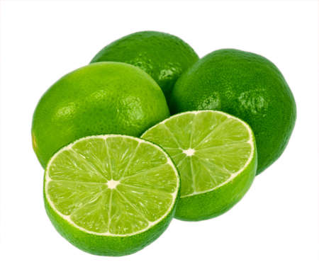 Green limes isolated on a white background. One lime is cut in half. Imagens