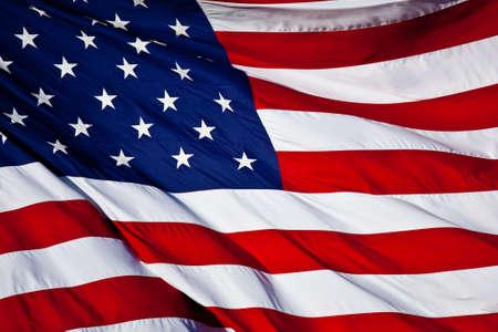 Eine amerikanische Flagge Hintergrund einwirken, die den Wind Standard-Bild - 4506170