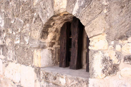 An old window at the Alamo.  Will make a good design piece.  Good detail. Imagens
