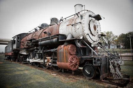 railway transportation: an old steam train at a train depot  Stock Photo