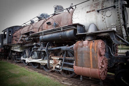 an old steam train at a train depot  Imagens
