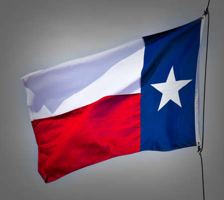 A new Texas flag flapping in the wind. photo