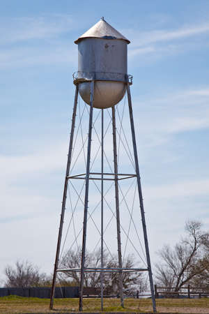 an old watertower on a farm