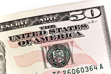 白い背景の上に広げた 50 の 50 ドル紙幣のスタック 写真素材