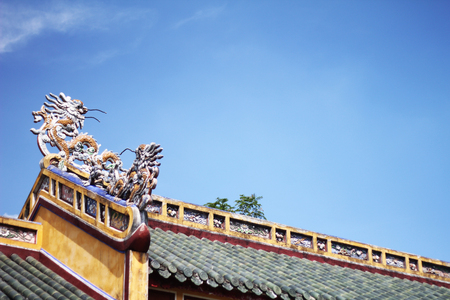 Dragon statue on roof and beautiful sky in Vietnam
