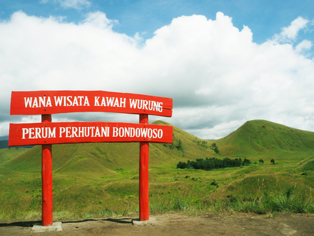 guide post and Meadow on mountain ,from Indonesia 写真素材