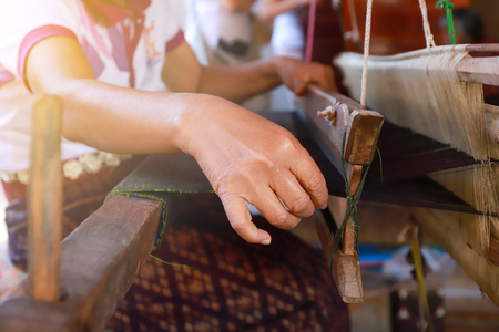 Weaving silk by hand made Stock Photo