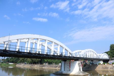 White railway bridge and sky