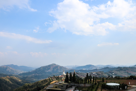 Buddha statue With temples and sky and mountains 写真素材