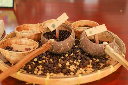 Roasted coffee press  In a wooden tray 写真素材