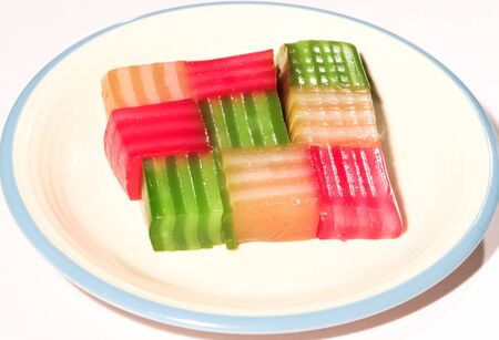 Many colored sweets are placed on a white plate. 写真素材 - 133429709