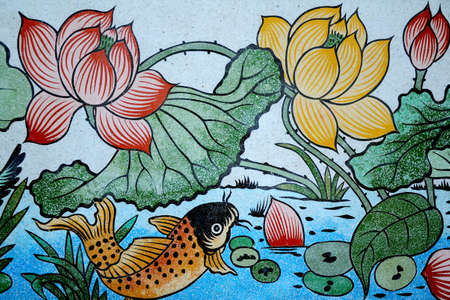 Fish and Lotus painting on stone wall