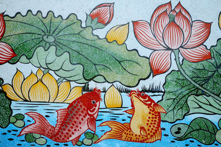 Fishes ad Lotus paining on stone wall.