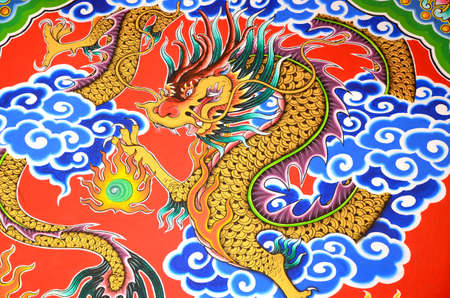 Golden dragon painting on stone wall. photo