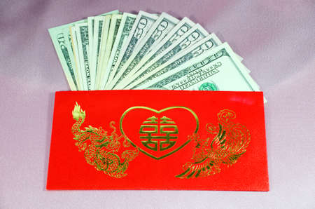 Ang Pao  a red envelope with good words and lucky sign contains gift of money for a Chinese wedding ceremony  photo