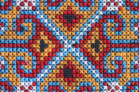 Cross stitch embroidery on canvas