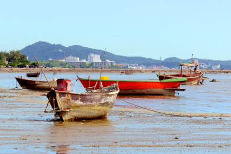 Fishing boat on the shore at low tide