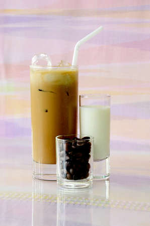 Iced coffee with milk and crisp coffee beans  photo