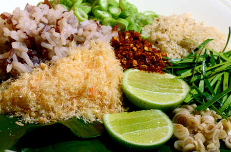 Thai Cuisine  Khao Yam in Southern Style   A kind of rice salad with plenty of vegetable dressing with special salad dressing called  Budu Stock Photo - 22851264