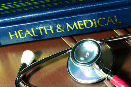 clinical research: Stethoscope and medical text book on the doctors desk