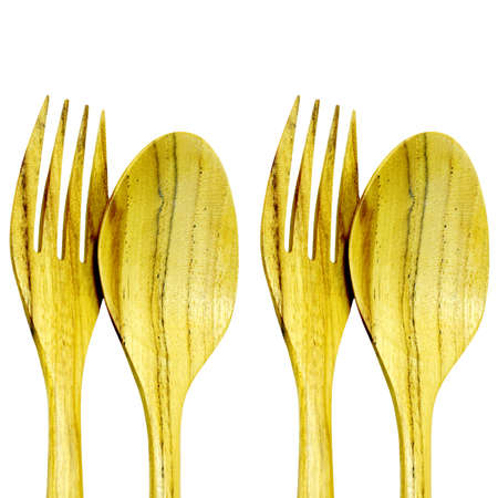 Wooden forks and spoons isolated on white background  photo