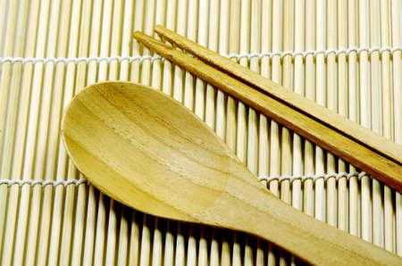 teak: Teak wood kitchenware on bamboo mat background  Stock Photo