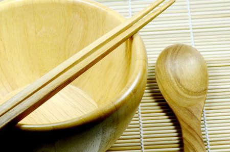 bamboo mat: Teak wood kitchenware on bamboo mat background  Stock Photo