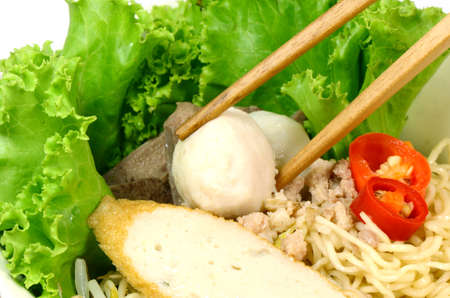 Home made egg noodles in Chinese style with fish ball, mince pork and vegetable  photo